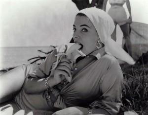 joan collins eating a banana